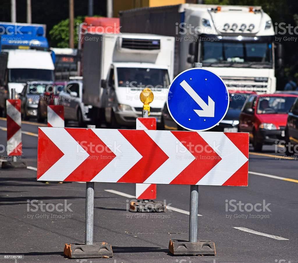 Arrow signs at the road crossing stock photo