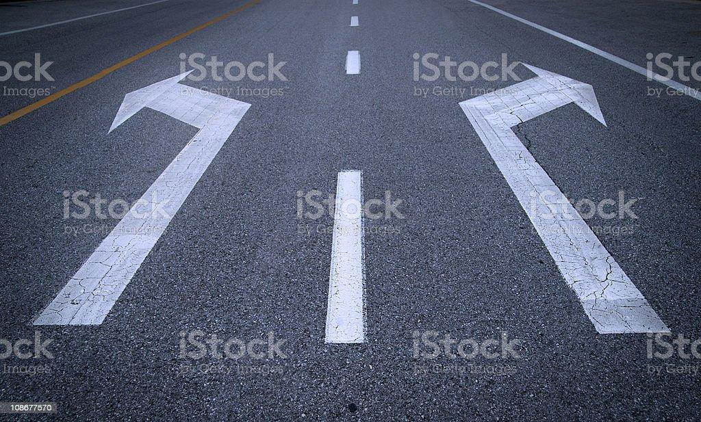 Arrow signs on asphalt stock photo