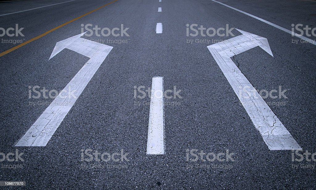 Arrow signs on asphalt stock photo