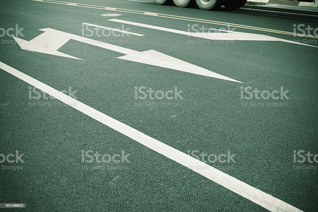 Arrow signs on asphalt royalty-free stock photo