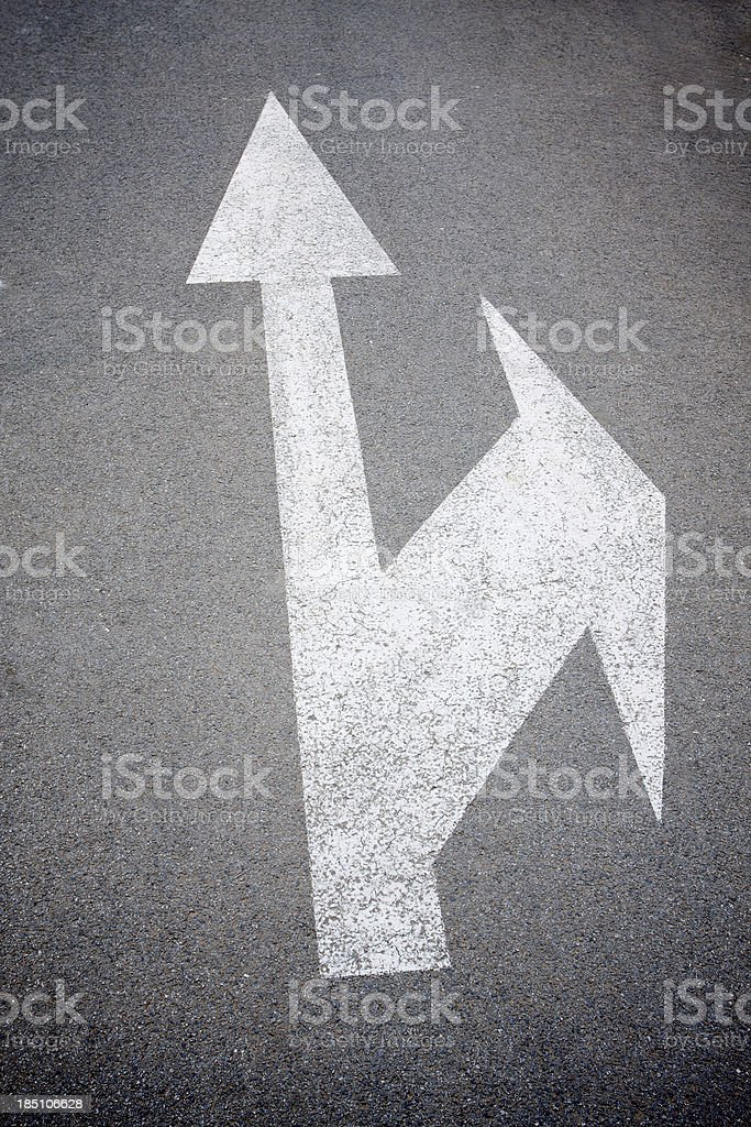 Arrow signs on asphalt royalty-free stock photo