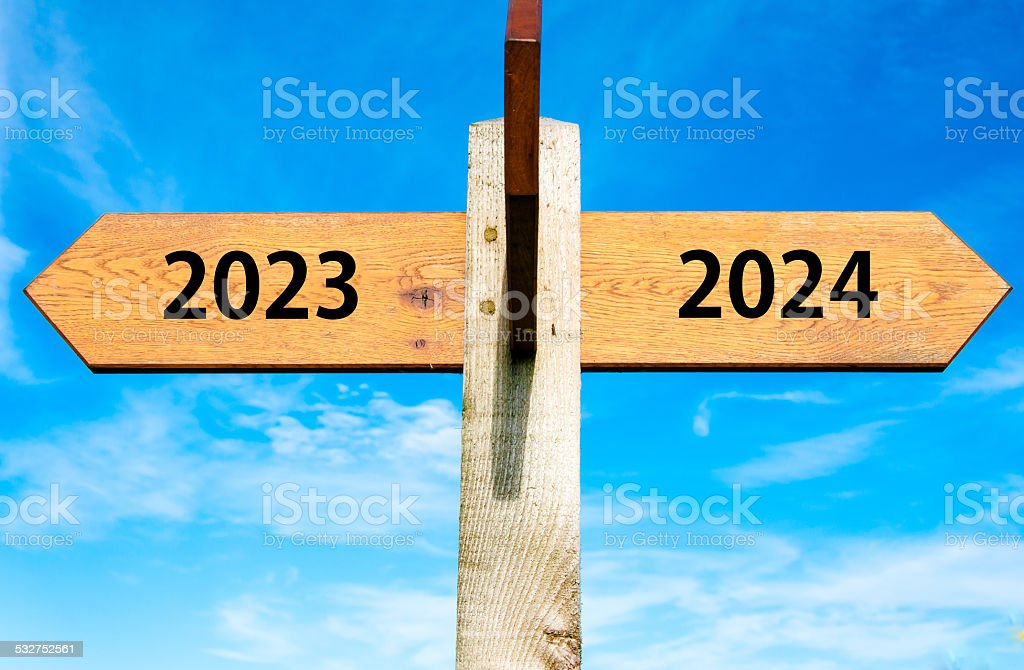 Arrow signs with Years 2023 and 2024, New Year concept stock photo
