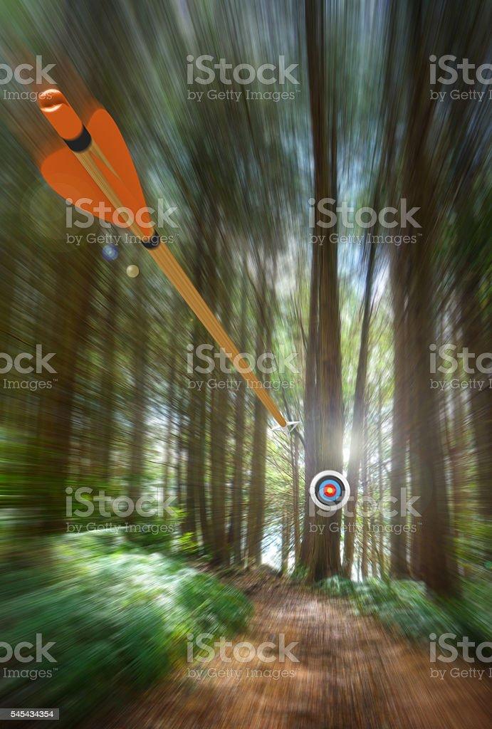Arrow speeding to archery target with motion blur stock photo