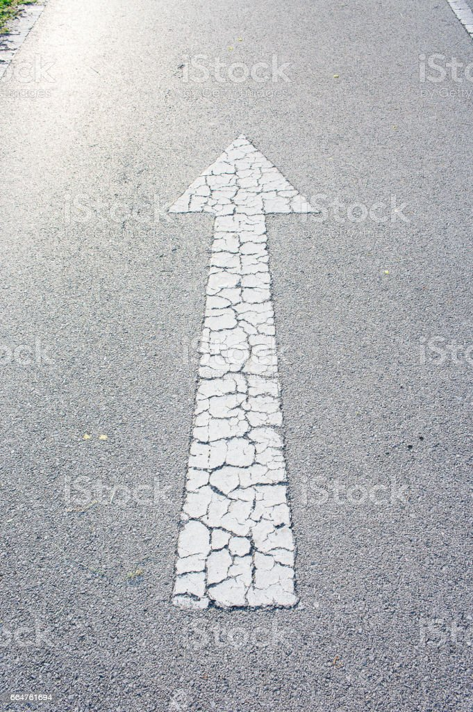 Arrow straight on the road background stock photo