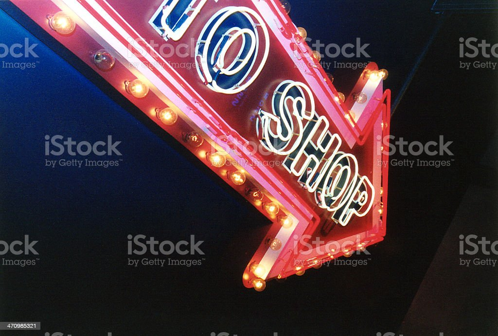 Arrow TO SHOP neon sign royalty-free stock photo