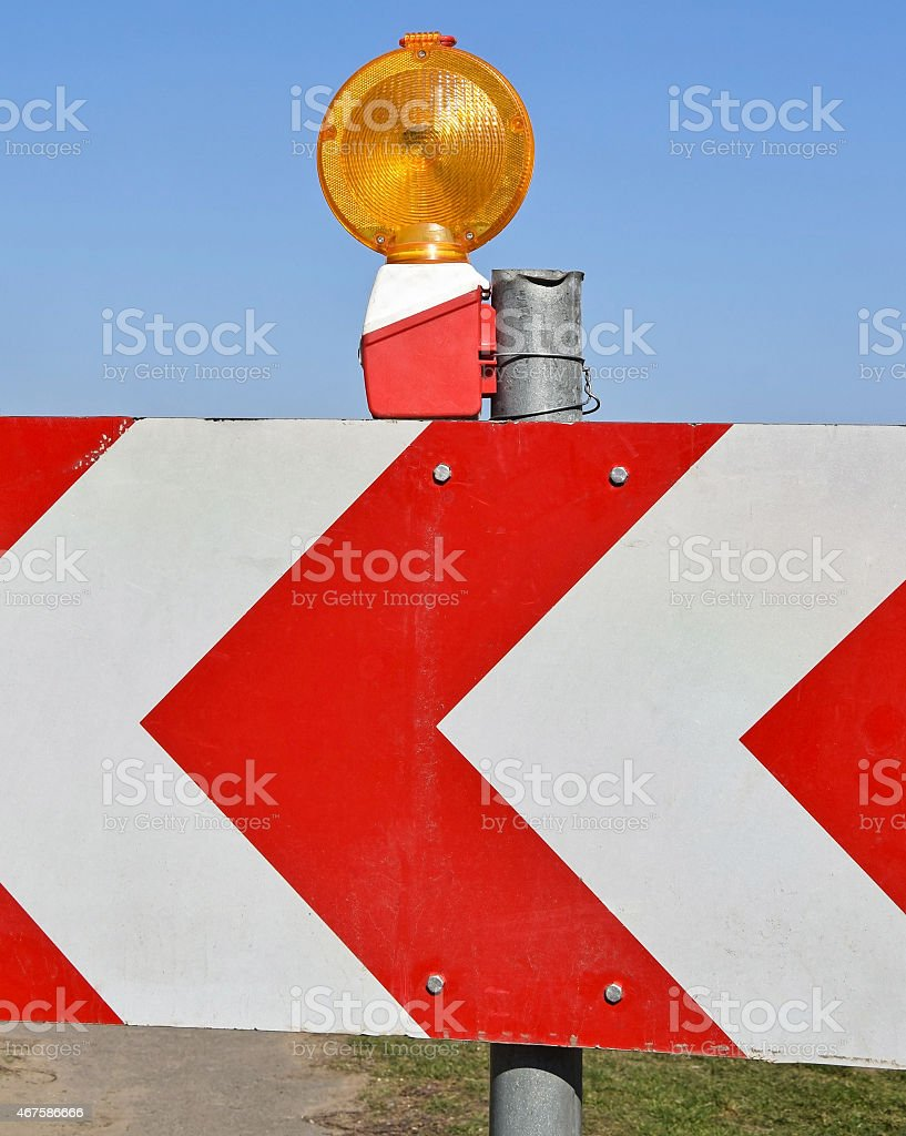 Arrow traffic sign with lamp stock photo
