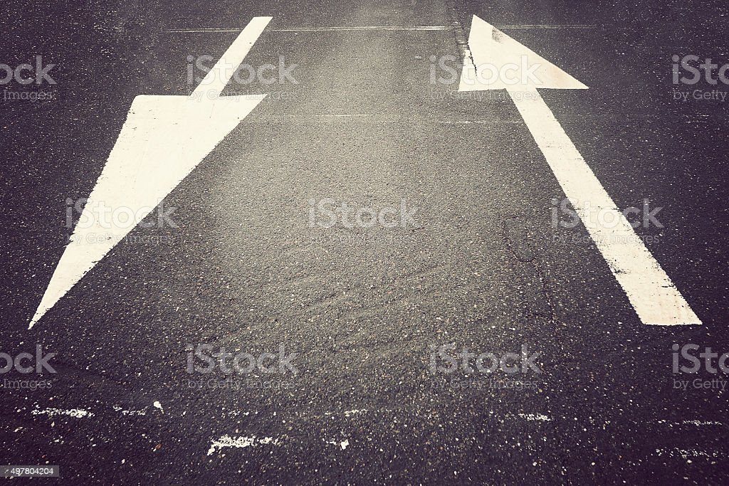 Arrow up and down on street stock photo