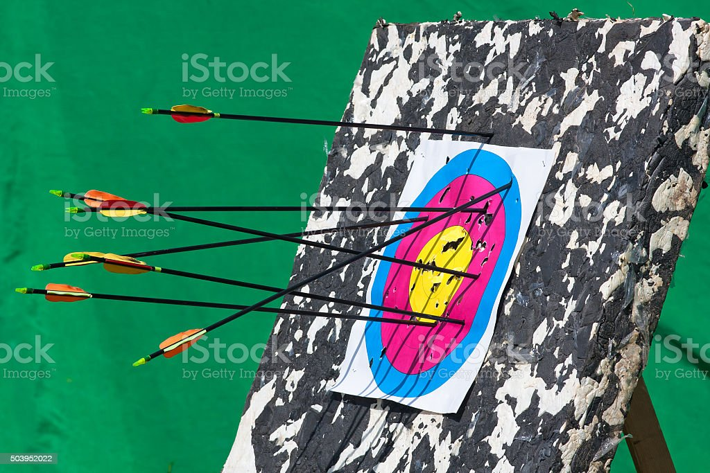 arrows hitting an archery target stock photo