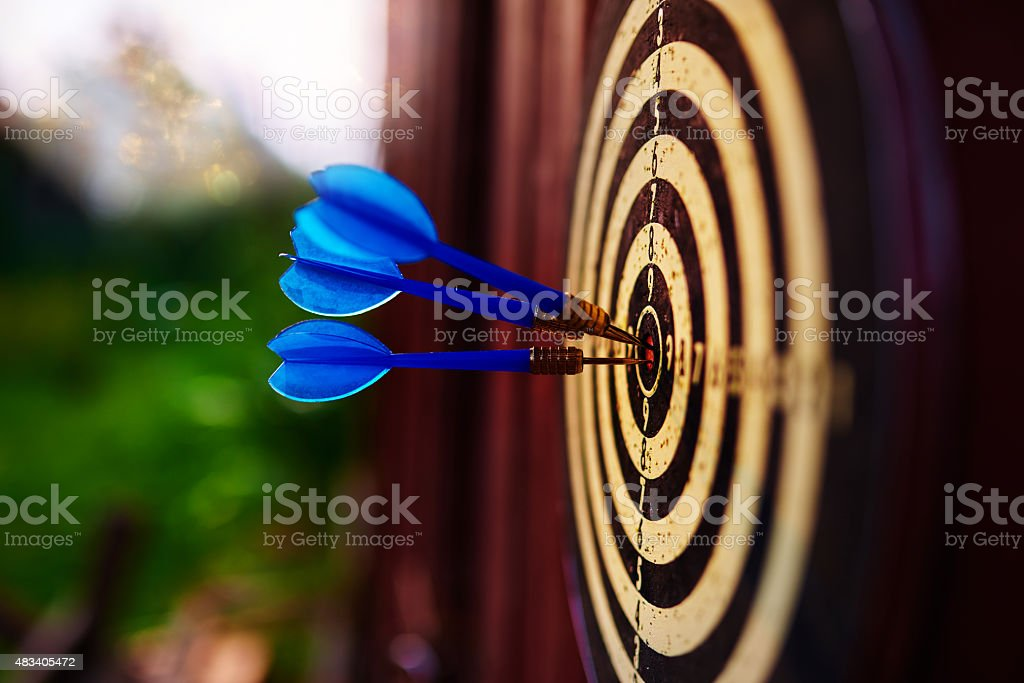 arrows in darts board stock photo