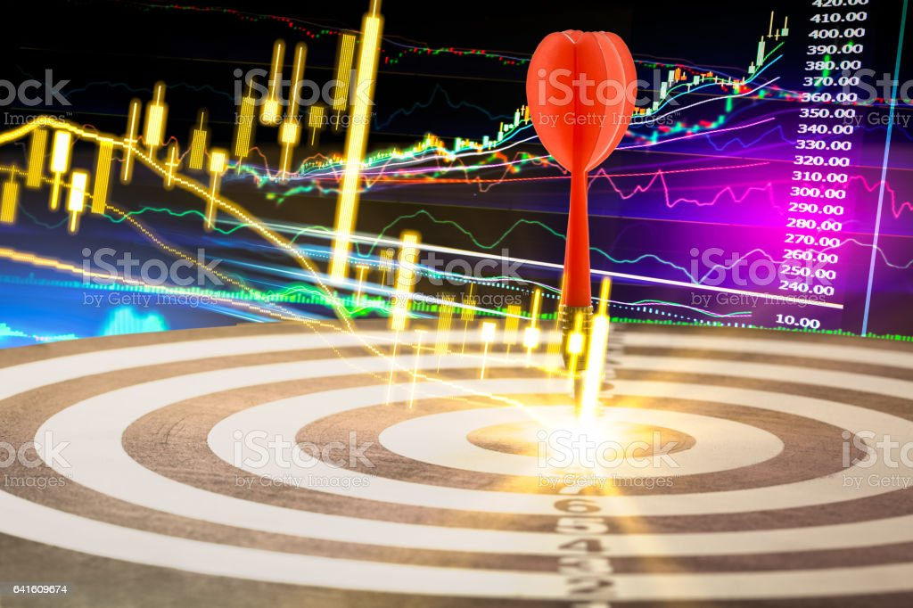 Arrows on dart board with stock market graph background mean stock photo