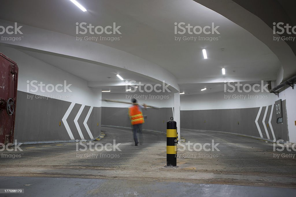 Arrows point the way inside of a city parking structure. royalty-free stock photo