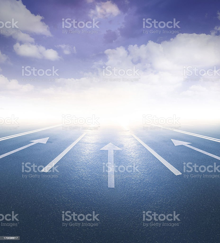 Arrows pointing into bright light stock photo