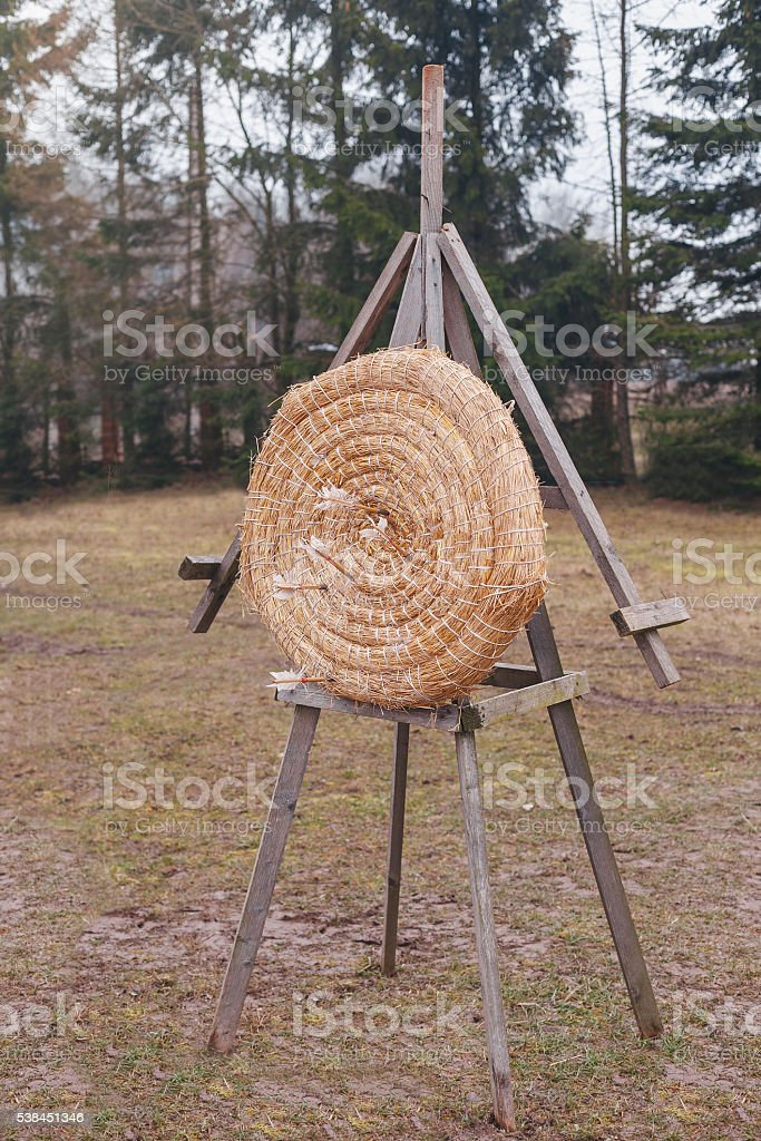 Arrows stuck into a target made of straw stock photo