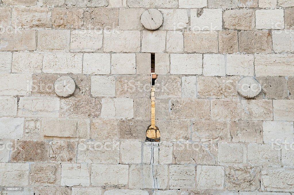 Arrowslit  at the old city wall, Jerusalem royalty-free stock photo