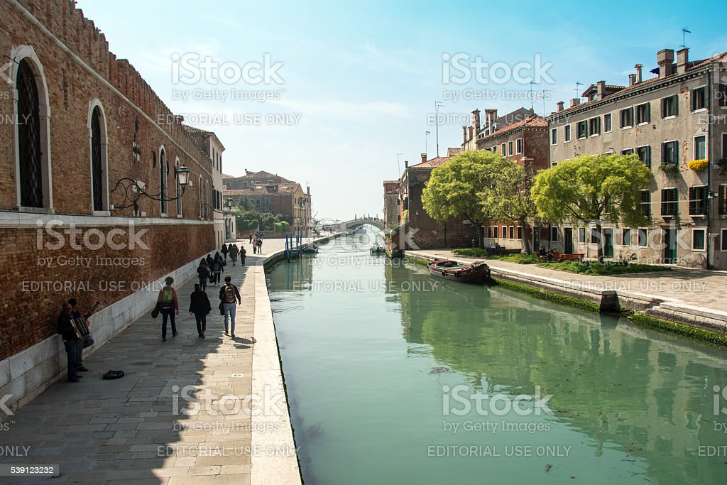 Arsenale canal in Venice showing the walkway to the buildings stock photo