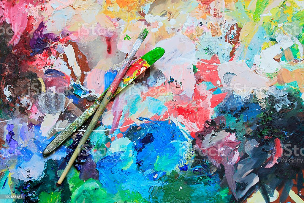 Art brush and knife on the palette for mixing stock photo