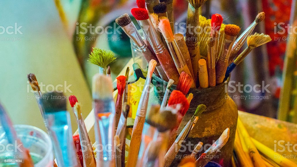 Art brushes colors in painting studio stock photo