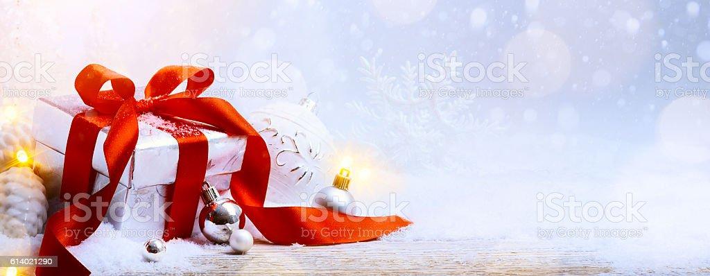 art Christmas gift box and Christmas decoration on light backgro stock photo