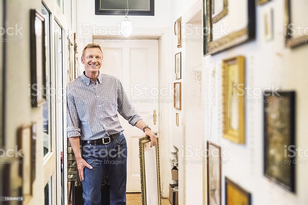 Art Collector in old Apartment Corridor stock photo