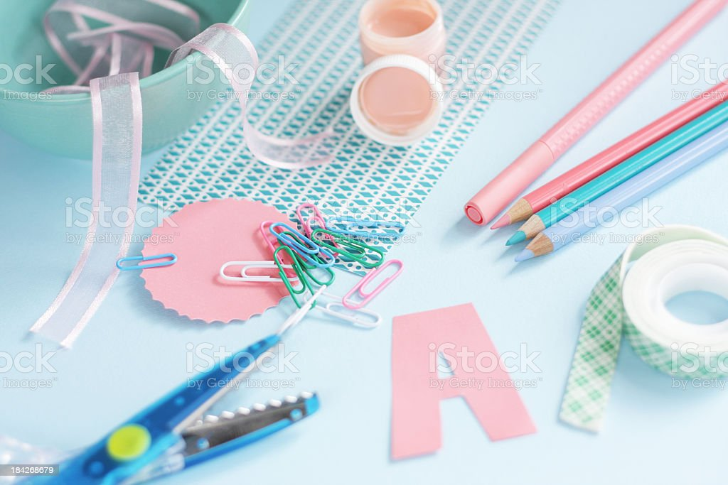 Art craft supplies on blue, green and coral on blue background stock photo