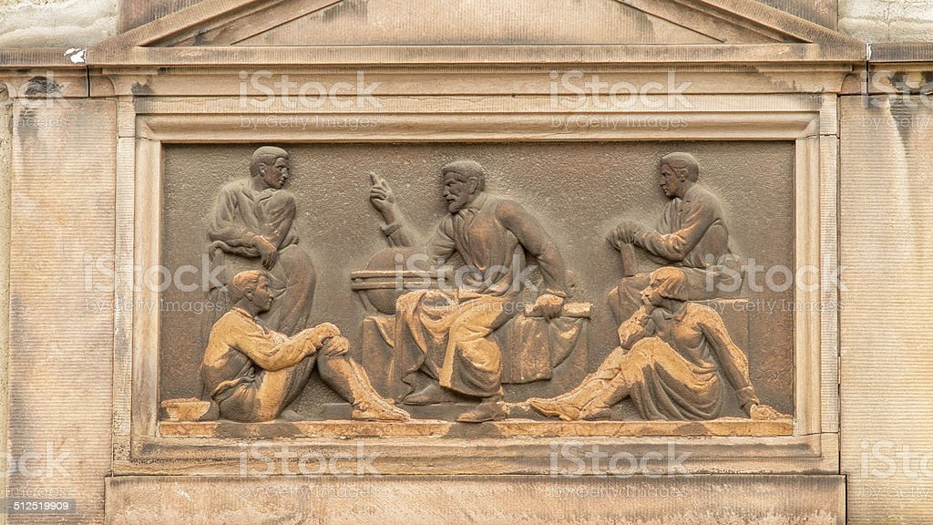 Art Deco inspired classical relief of a teacher stock photo