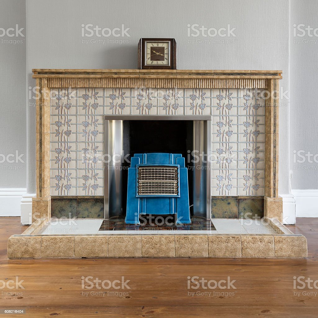Art deco lounge details with fireplace, fire and clock stock photo