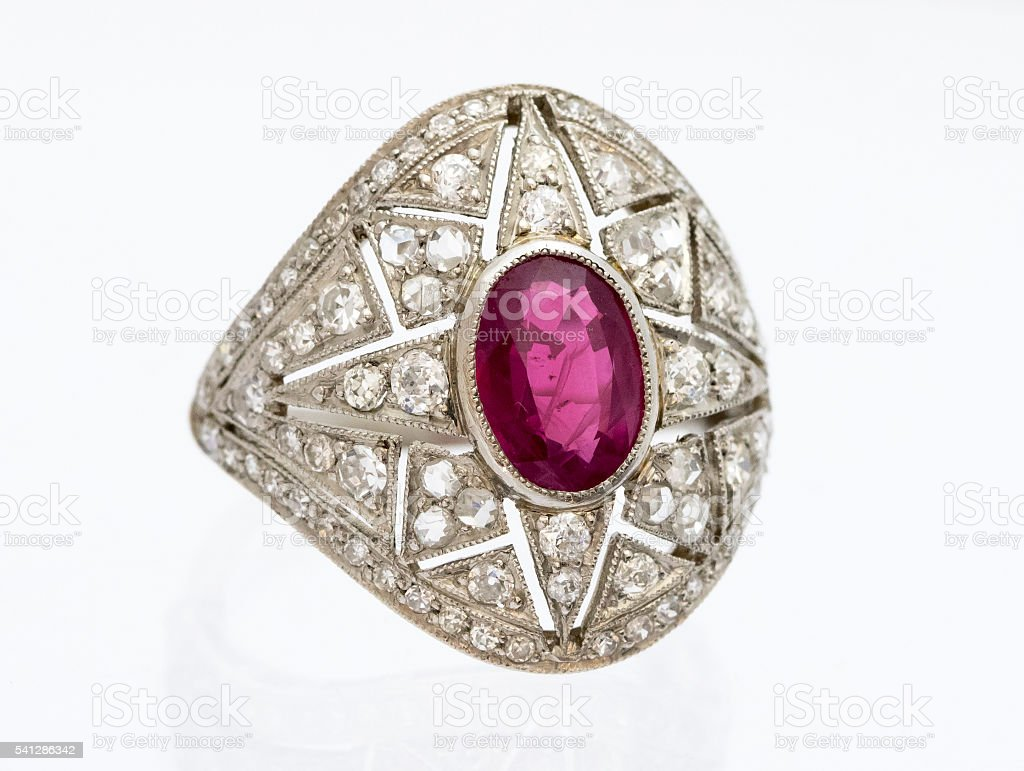 Art Deco style ruby and diamond fancy cluster ring stock photo