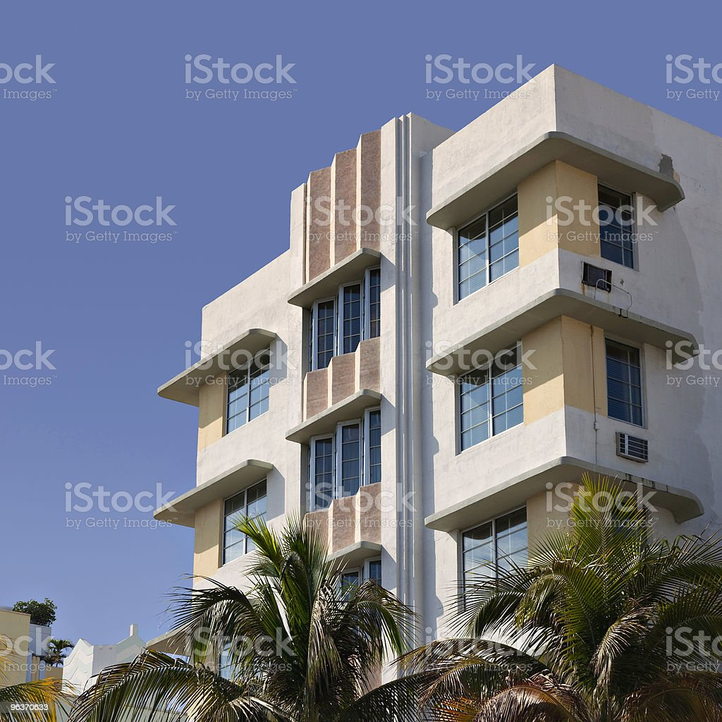 Art deco upper facade with palm trees royalty-free stock photo