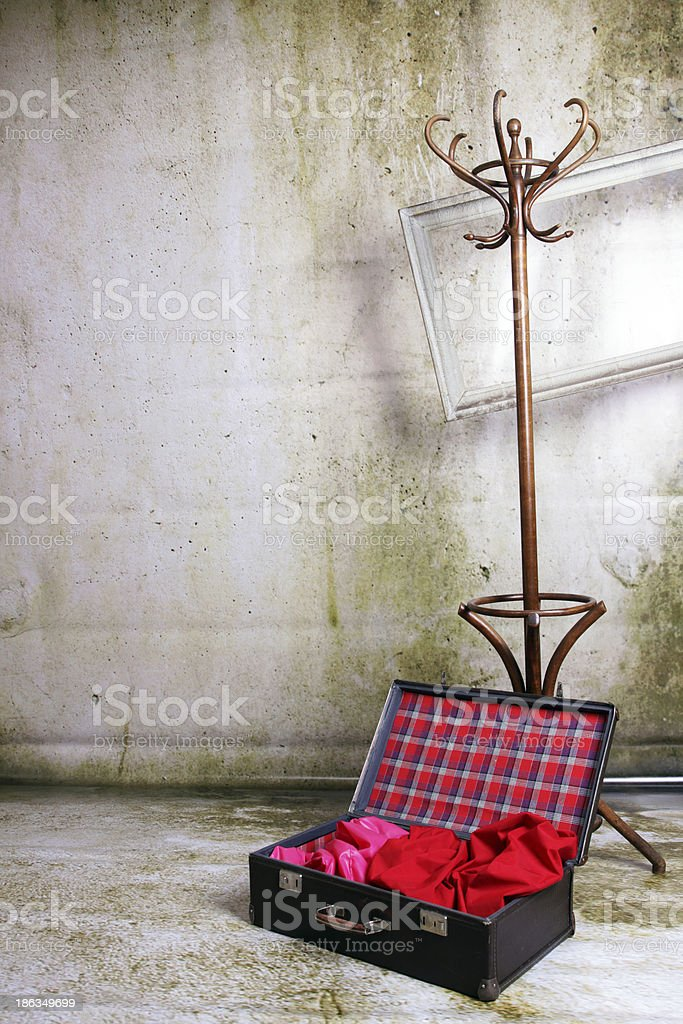Art decoration suitcase and wooden hanger royalty-free stock photo