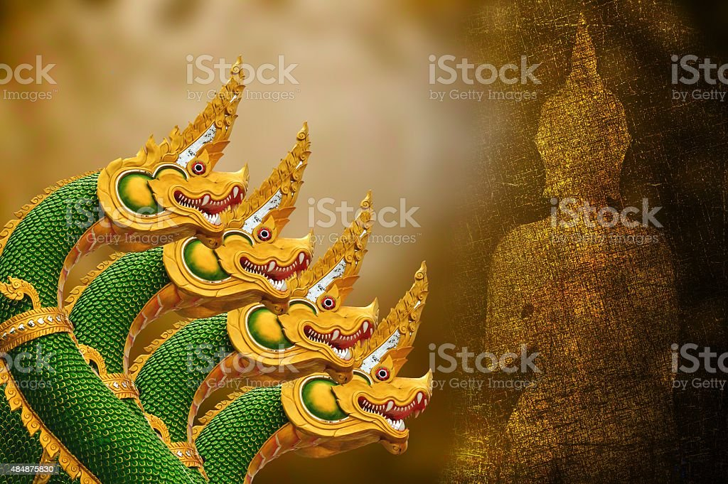 art four King of Nagas statue and buddha shadow stock photo
