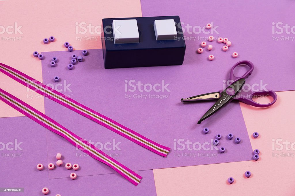 Art & Hobbies:  Scrapbooking beads, ribbons, scissors and punch. stock photo