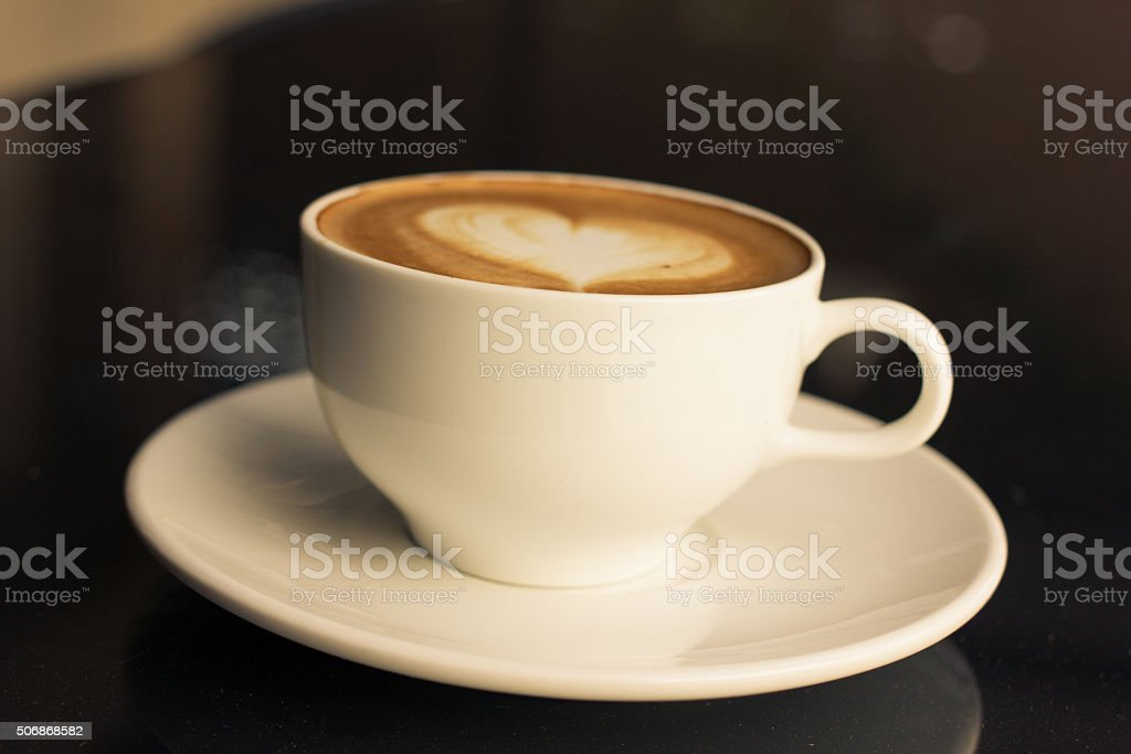 Art latte or cappuccino coffee. stock photo
