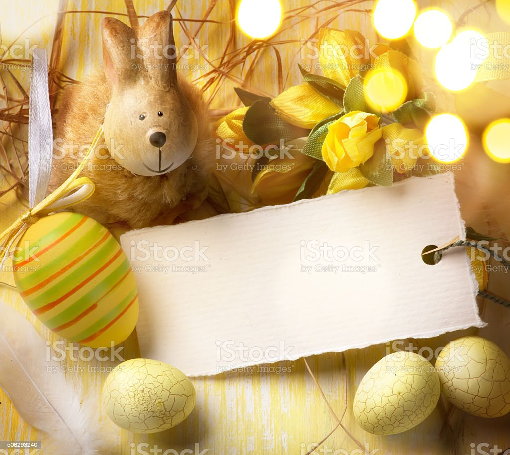 art Little Easter bunny and Easter eggs stock photo