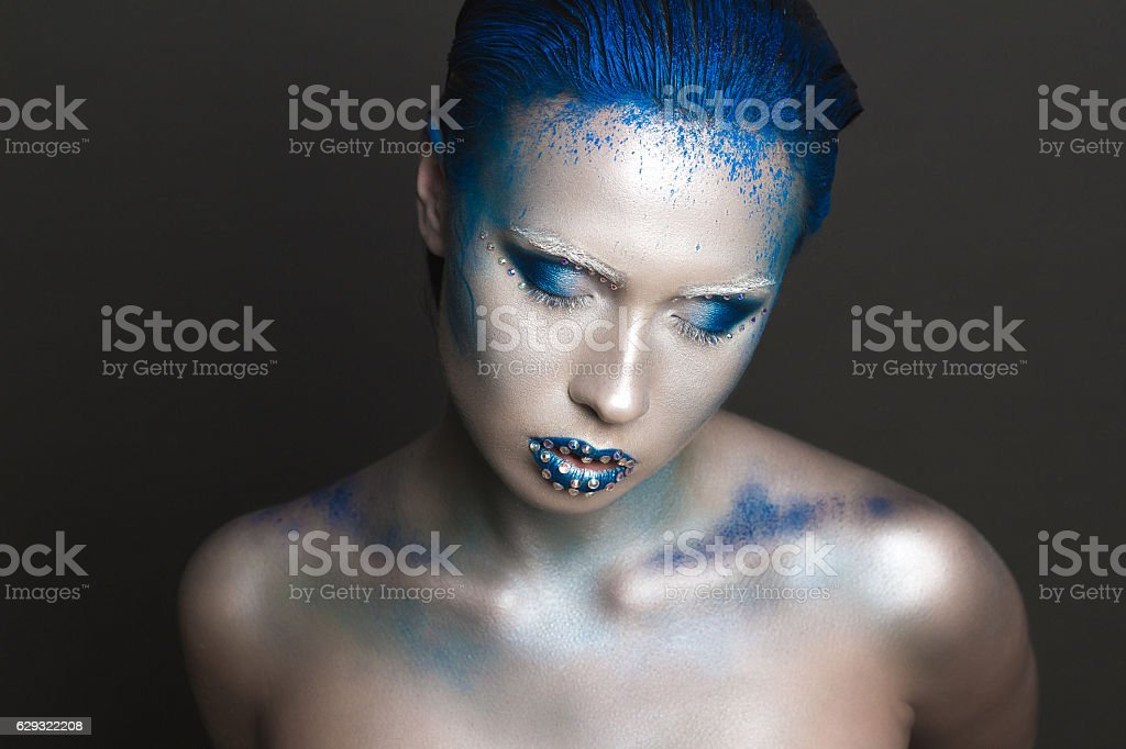 Art Makeup with Blue Hair and Rhinestones stock photo