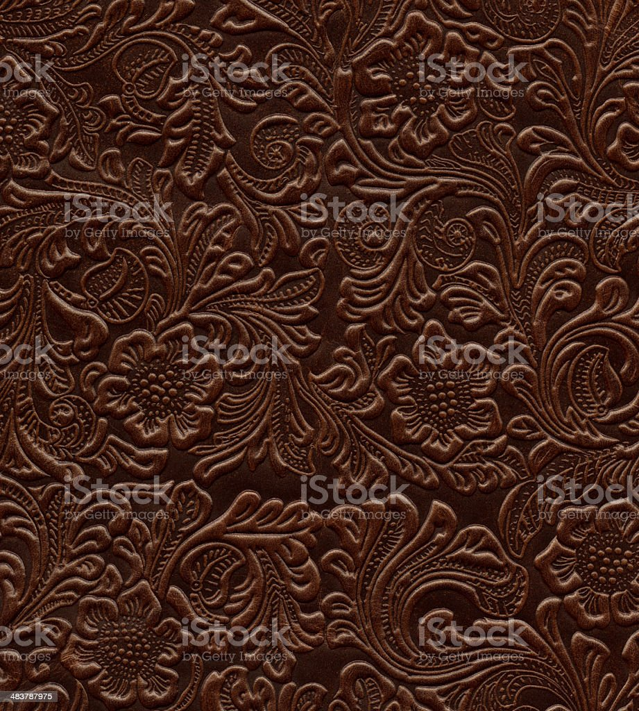 Art Nouveau floral pattern on real leather royalty-free stock photo