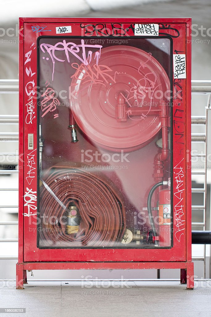 Art on Fire Hose Cabinet stock photo