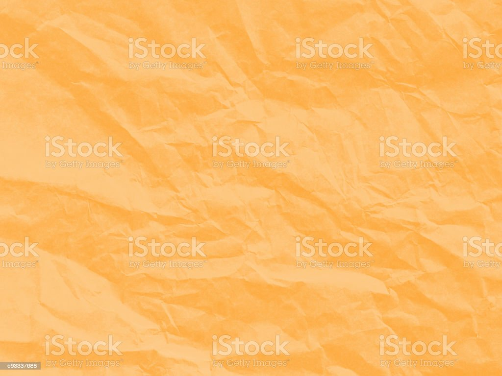 Art paper texture. Unique crumpled orange paper sheet for background. stock photo