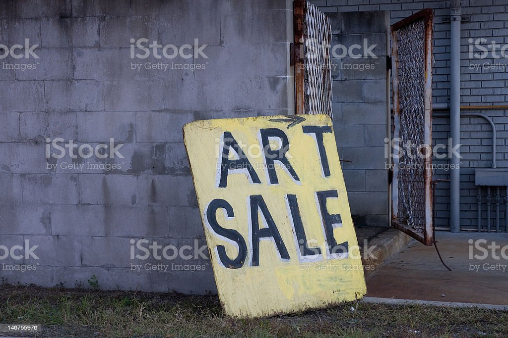 Art Sale Sign Board  Centered Leaning Against Block Wall stock photo