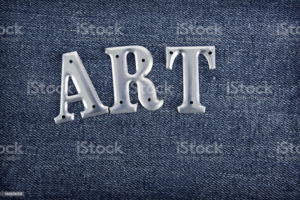 Art - spelled out in metal letters on denim stock photo