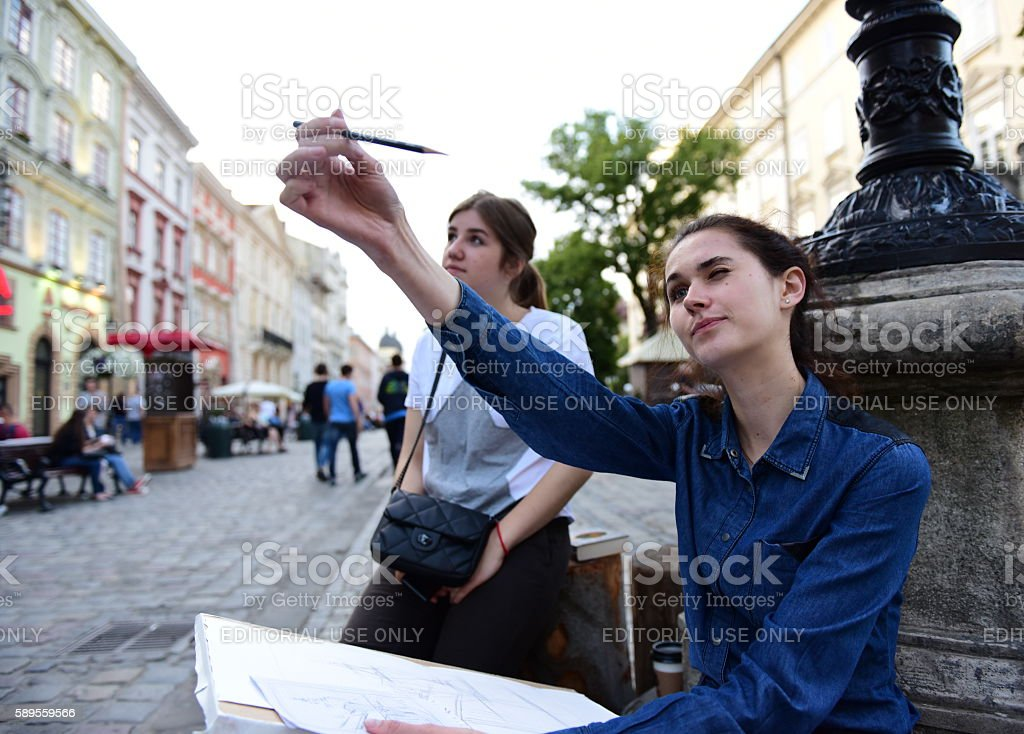art student drawing outdoors stock photo