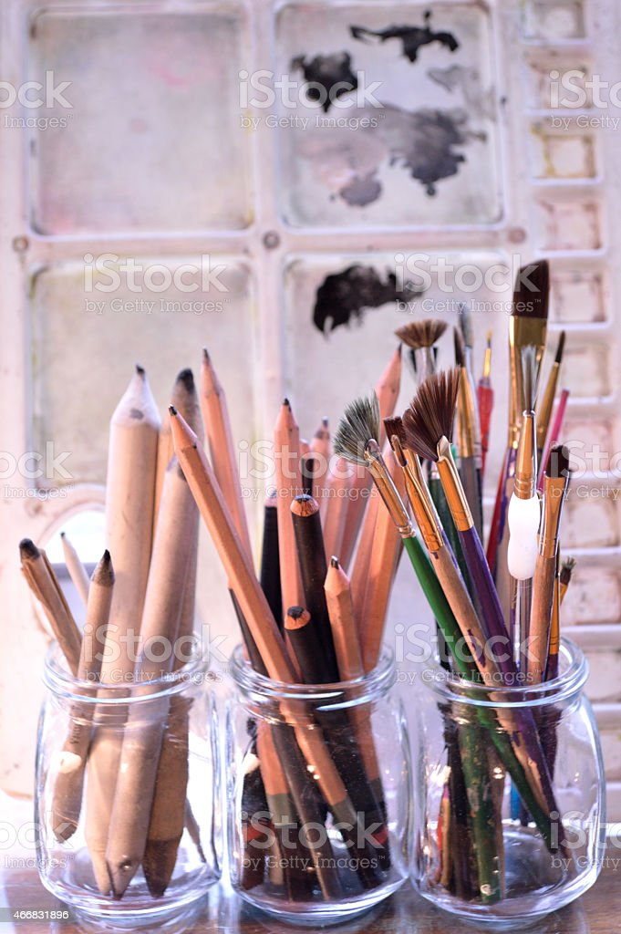 Art supplies in front of art palette. stock photo