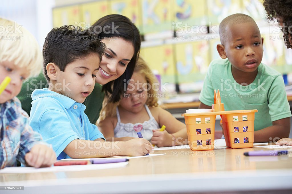 Art teacher with elementary school children stock photo
