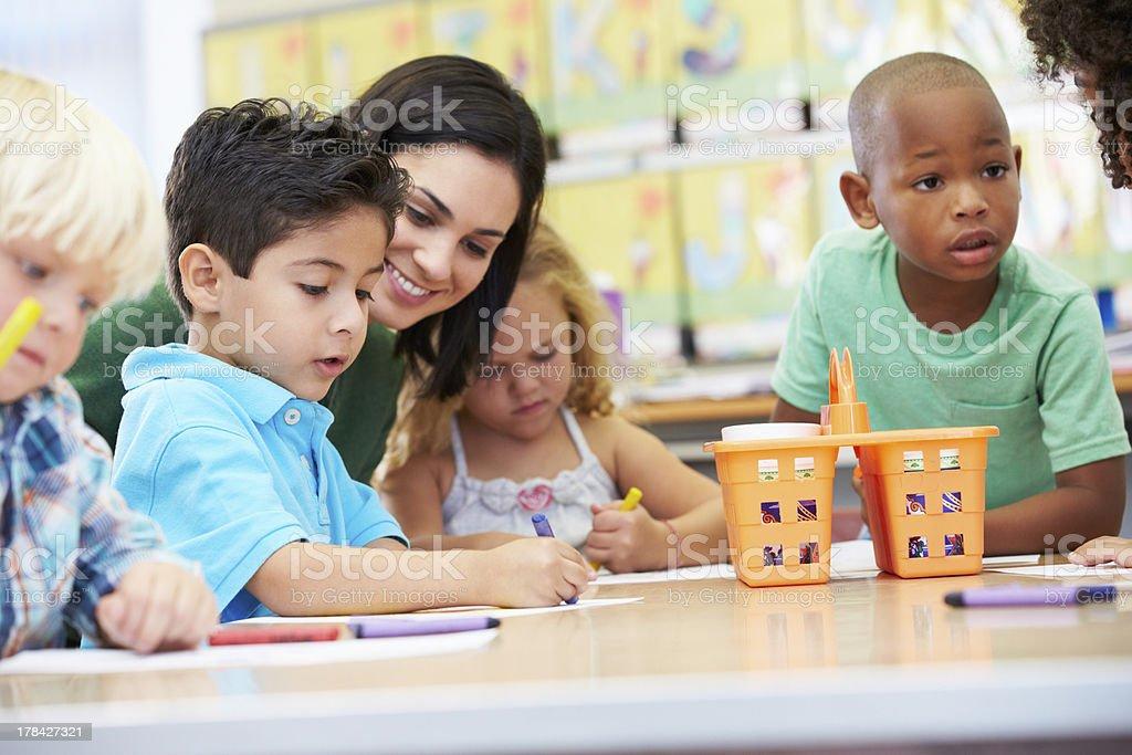 Art teacher with elementary school children stock photo