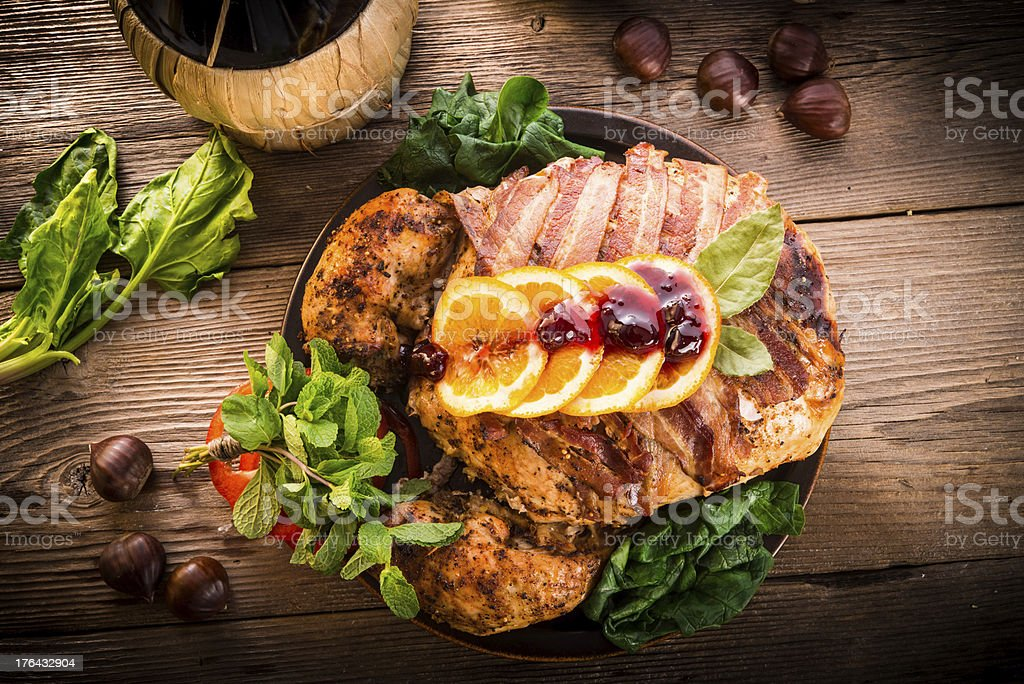 Artfully plated and garnished roast turkey on a wood table stock photo