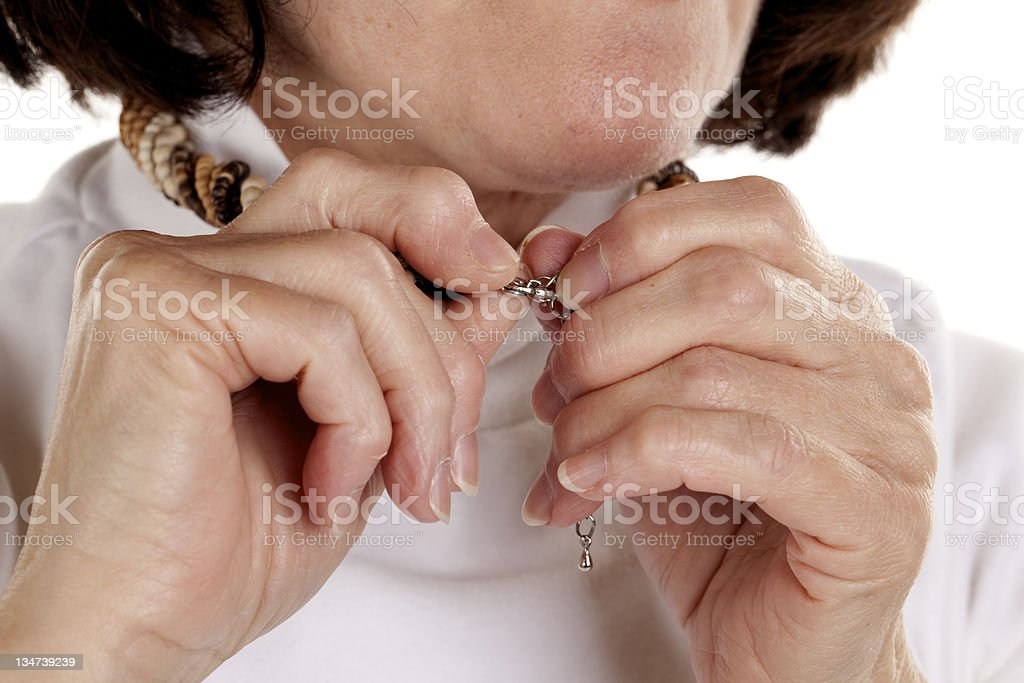 arthritic hands necklace stock photo