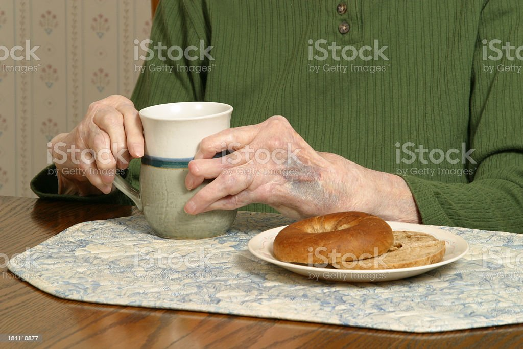 Arthritic Hands With Bagel and Coffee Arthritis Rheumatism royalty-free stock photo
