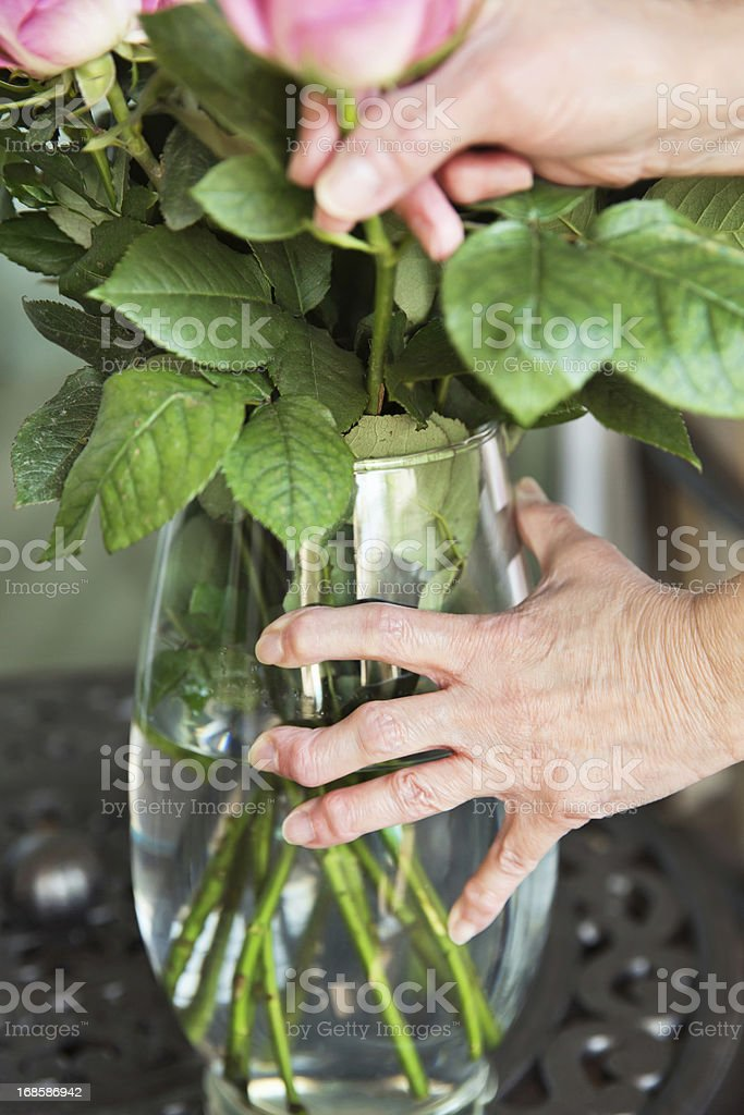 Arthritis: Arthritic senior hands holding a flower vase royalty-free stock photo