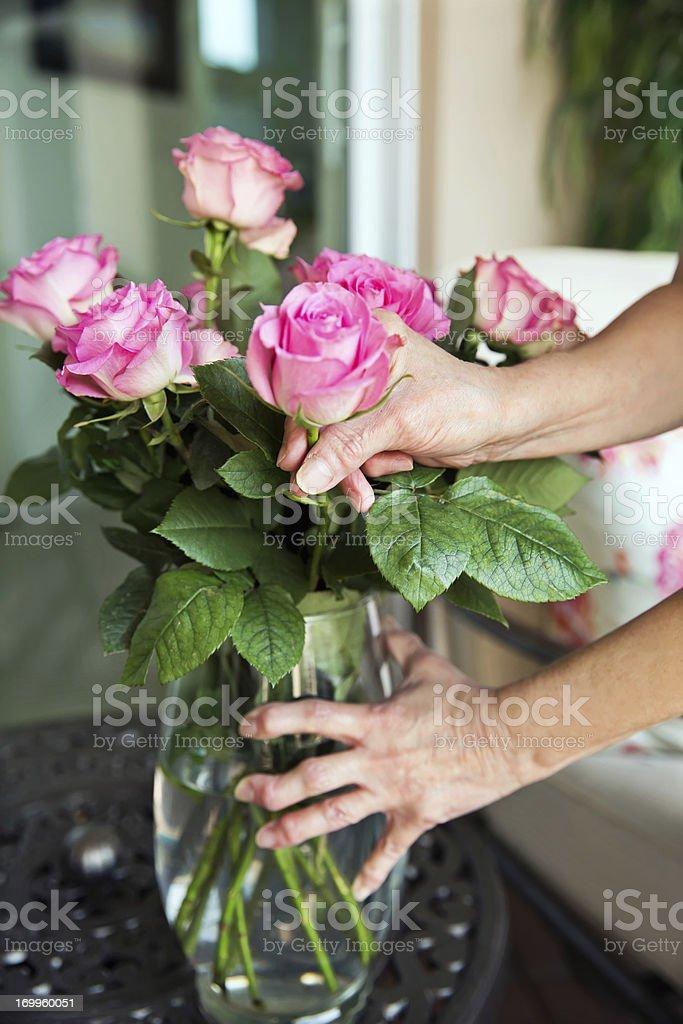 Arthritis: Arthritic senior hands holding a flower vase royalty-free stock photo