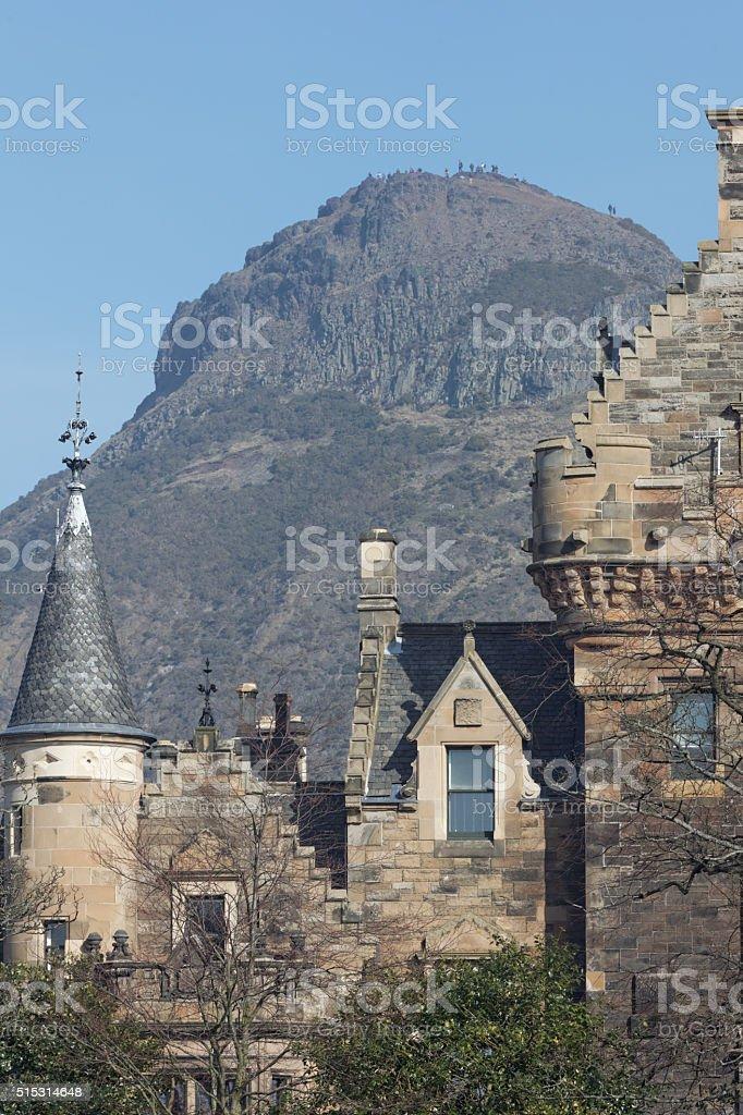 Arthur's seat in Edinburgh behind classic scottish building stock photo