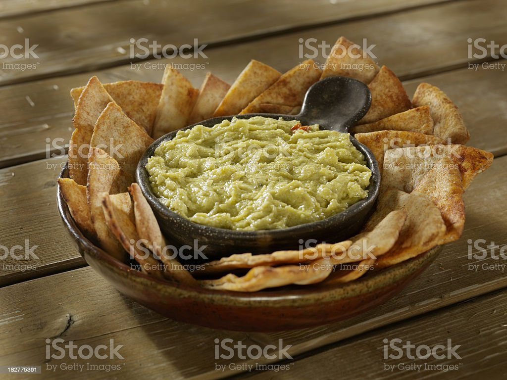 Artichoke and Chickpea Hummus with Pita Chips stock photo